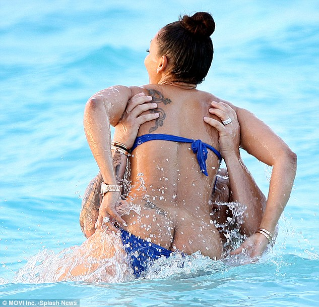 Sun's out, bum's out: Mel, 40, suffered an unfortunate wardrobe malfunction as she fooled around in the sea with Stephen Belafonte.
