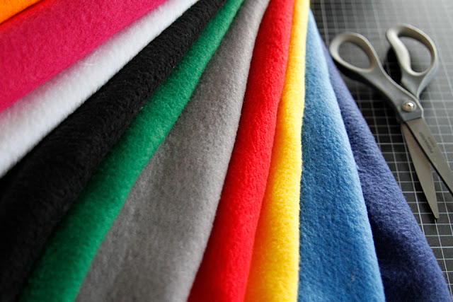 Stack of coloured polar fleece fabrics for making DIY dog tug toys