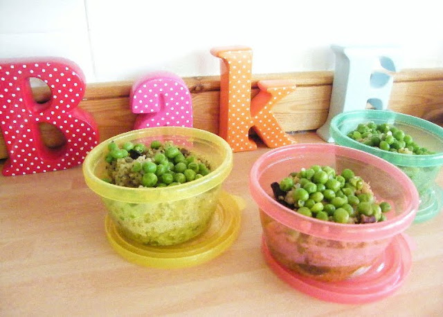 Herby Quinoa Salad with Mushrooms in little plastic tubs topped with peas for a toddler