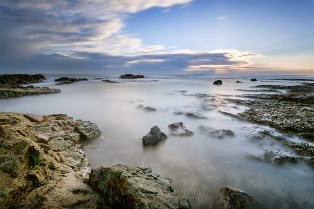 Bamburgh coast at sunrise with a long exposure by Martyn Ferry Photography