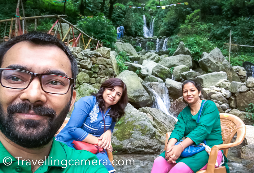 On this Rakshabandhan, I visited Dalhousie to meet my sister and niece. During the visit, we planned to walk down from Dalhousie Public School of Panchpula Waterfalls. This Photo Journey shares some of the photographs clicked during the walk and around Panchpula waterfalls. All photographs shared in this Photo Journey are clicked with Huawei P9.Gandhi Chowk in Dalhousie market is around 1.5 kilometers from Dalhousie Public school and it's a downhill. And there is a road which again goes down towards Panchpula from Gandhi Chowk. It should be around 2-3 kilometers from Gandhi Chowk. So it was around 4/5 kilometers walk from DPS till Panchpula. Above photograph is clicked at Gandhi Chowk of Dalhousie town, which is a part of mall road.It was a bright sunny day and clouds were having fun in bright blue sky. I clicked hundreds of photographs of these clouds while walking down to Panchpula and shared few of them here. I have been to Panchpula 8 years back and now I wanted to see how it has changed over the years.During the walk we observed few interesting things. Above photograph shows the parking slot of one of the houses built on the hill. This was very close to road and standing on top of high pillar made up of concrete.It was interesting to reach 'Rai Bahadur' on the entry gates of one of the villas around Dalhousie hills. There are lot of beautiful villas around Dalhousie town and most of them belong to families who had good connections with britishers, or business families. Good chunk of villas belong of army officers. So overall it gives you a feel of idea retirement destination.Here is another photograph showing path to a huge village up in the hill.s The white compound you see at the distance is Dalhousie Public School and they have installed a huge flag in the campus.On the way from Dalhousie market to Panchpula there are few places to have rest and enjoy the views of valleys & hills. We didn't stop in any of these and kept moving till we reach Panchpula.It was a bright sunny day after heavy rains a day before. So monsoons are risky - either they spoil your day and you have to be inside the house or everything is fresh and bright like what you see in these photographsAs you reach Panchpula , you see this structure which is dedicated to Saradar Ajit Singh. This is the point from where you have to climb up. The Waterfall is just across this structure and on other side of the road. Like other tourist places, there few shops where shopkeepers would insist you to buy some local stuff. I was surprised to see folks selling kesar here and I know kesar is not grow locally. Probably it's brought from J&K.And as I saw the place, I realized that it has changed a lot. Now there are more shops on the way and a cafe close to the waterfall. There is Shiva Cafe which is pretty close to the waterfall. We spent some time around this cafe and had delicious snacks. The good part was that I didn't find litter here and I was extremely happy to see dustbins installed by this cafe.I am not a selfie enthusiast but the environment and 2 girls forced me to click this one :)It was fun to sip hot tea while sitting in chilled water body near Cafe Shiva.Vibha will be sharing her review about the tea we had at this cafe near Panchpula Waterfalls in Dalhousie.Overall it was fun to walk and have some peaceful time around Panchpula waterfall. To go back, we hired a cab. Usually cab charges 150 Rs for Gandhi Chowk but if you are in hurry and look desperate to book a cab, people may ask for 300 Rs.Bon Voyage !If you liked this post and found it helpful, I would request you to follow these things when traveling -- Manage your waste well and don't litter- Use dustbins. Tell us if you went to a place and found it hard to locate a dustbin.- Avoid bottlewatersin hills. Usually you get clean water in hills and water bottles create lot of mess in our ecosystem.- Say big no to plastic and avoid those unhealthy snacks packed in plastic bags. Rather buy fruits.- Don't play loud blaring music in forests of jungle camps. You are a guest in that ecosystem and disturbing the locals (humans and animals) is not polite