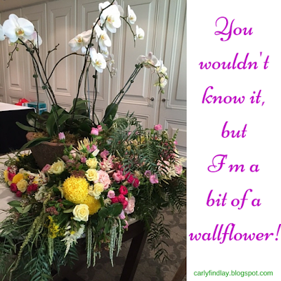 Flowers with caption 'You  wouldn't  know it, but  I'm a  bit of a  wallflower!'