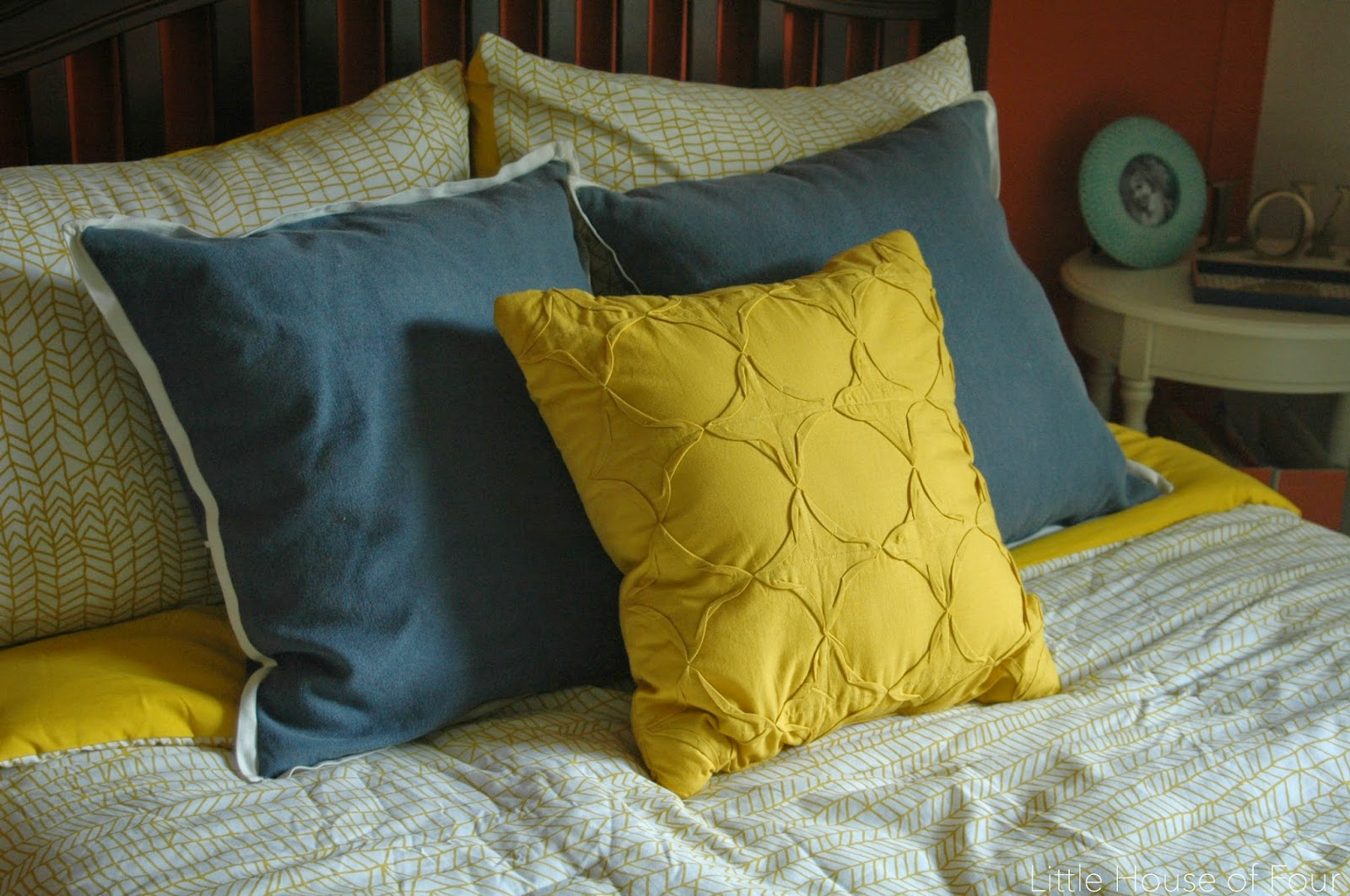 Navy and mustard colored pillows