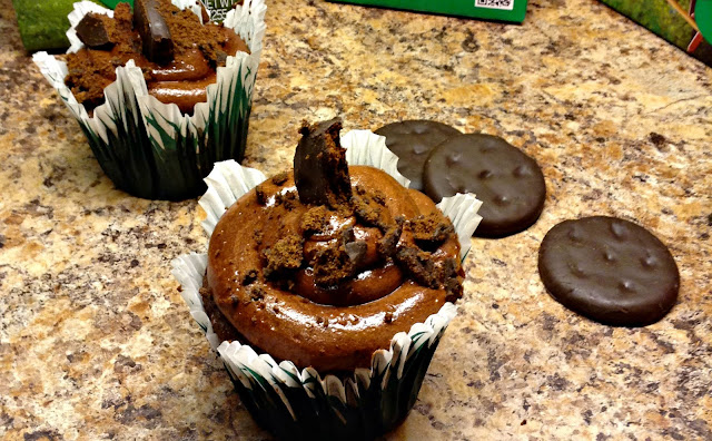 Thin Mint Girl Scout cookie crumbles on a whipped ganache topped cupcake
