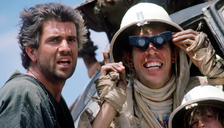 Mel Gibson & Bruce Spence in MAD MAX - JENSEITS DER DONNERKUPPEL (USA 1985). Quelle: Warner Bros.