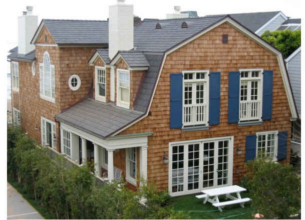 Grace and Frankie La Jolla beach house shingled exterior and blue shutters. #graceandfrankie #cedarshake #shingles