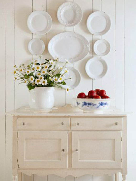 white painted furniture, white ceramic plates on the wall
