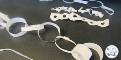 STEM Challenge: Build a paper chain! Using one piece of paper make the longest chain you can!