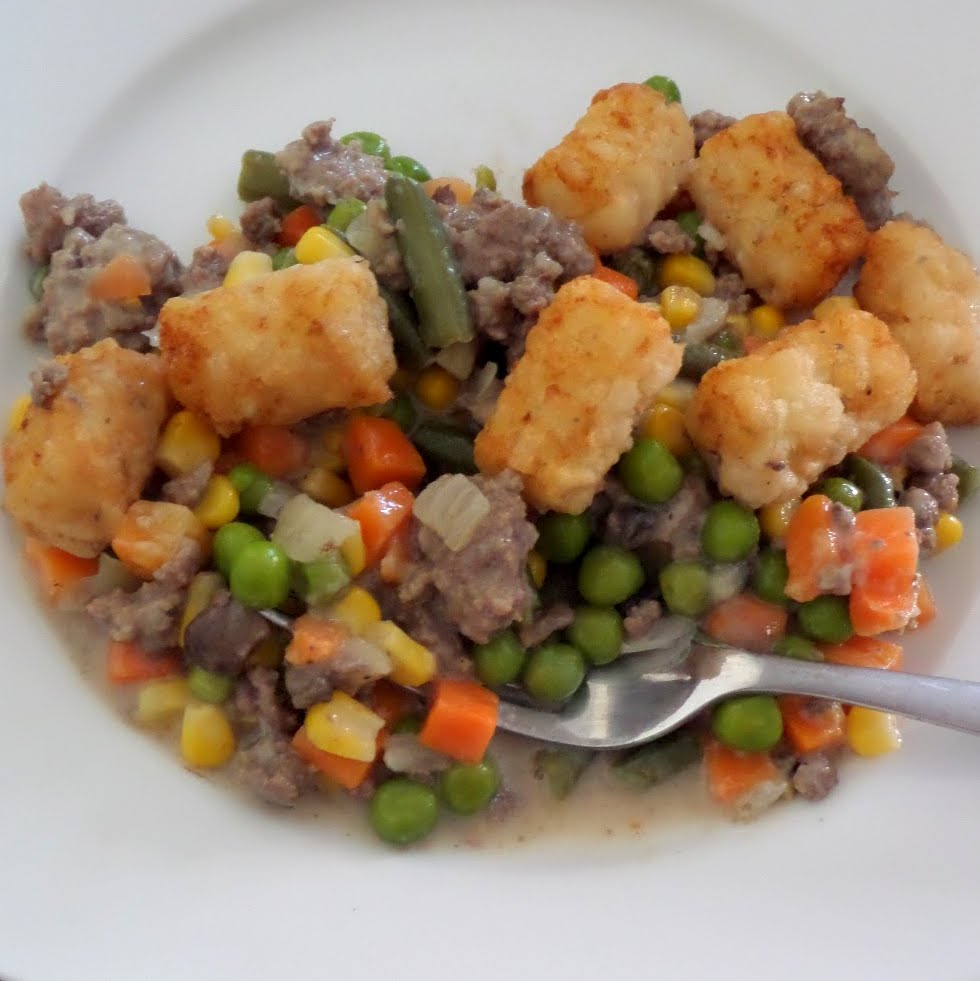 Tater Tot Hotdish:  Ground beef and veggies in a creamy sauce topped with tater tots.