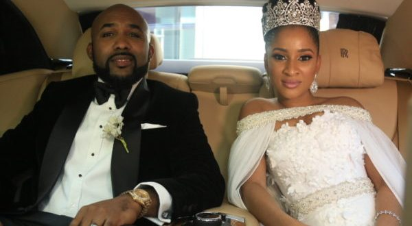 Banky-W-and-Adesua-Etomi-as-newlyweds-in-the-Wedding-party-600x330
