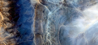 Allegory of radiography of the spine of the first man who tried to cross the desert of Africa, abstract surreal photo of African deserts from the air,