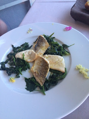 white fish (caught in Lake Garda), served with wild greens and wild flowers