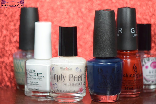 O.P.I Original Nail Envy, Pure Ice Super Star, Bliss Kiss Simply Peel Latex Barrier, O.P.I Incognito In Sausalito, China Glaze Seeing Red, Glisten & Glow HK Girl Fast Drying Top Coat