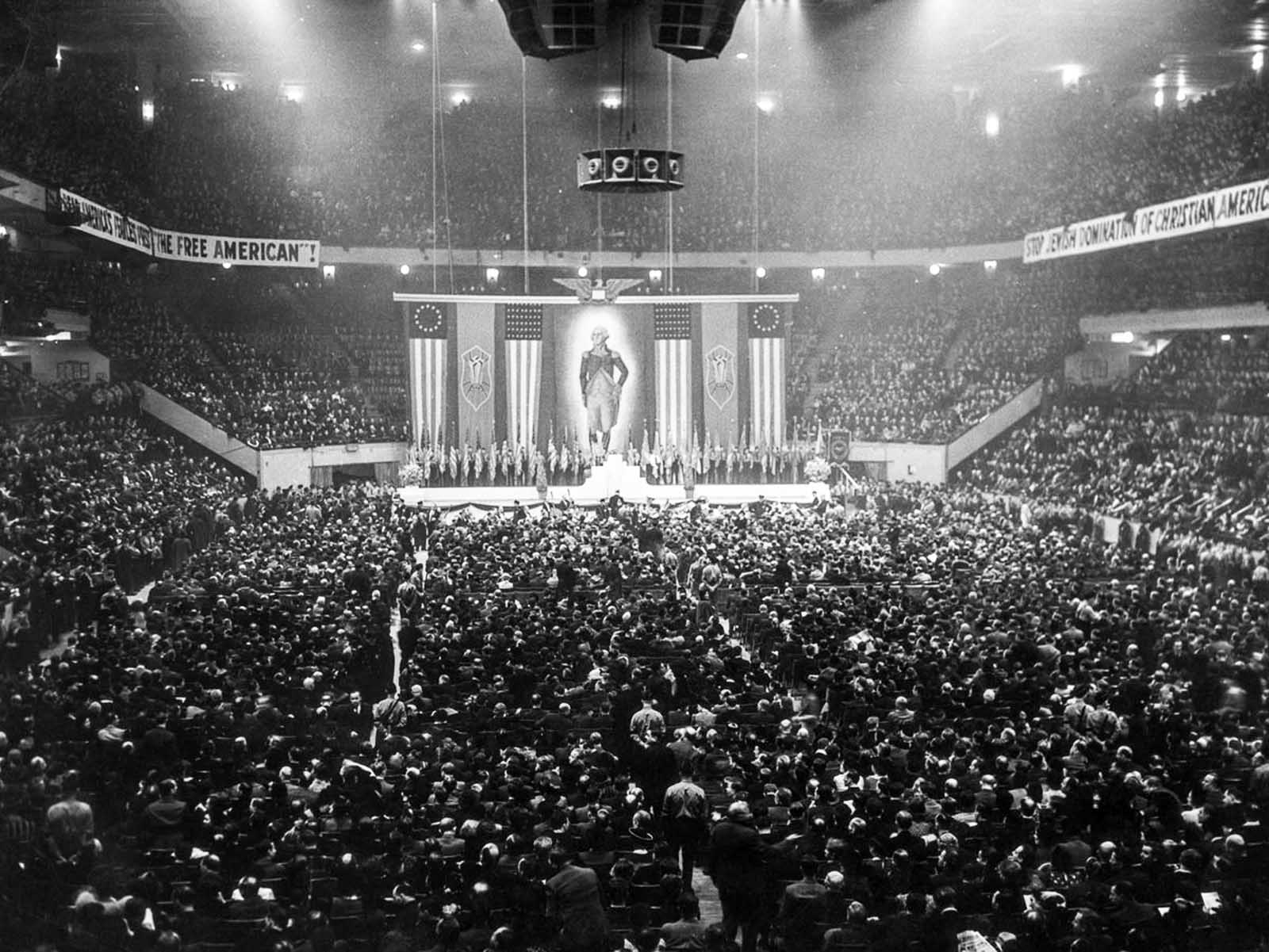 More than twenty thousand attend a meeting of the German American Bund, which included banners such as