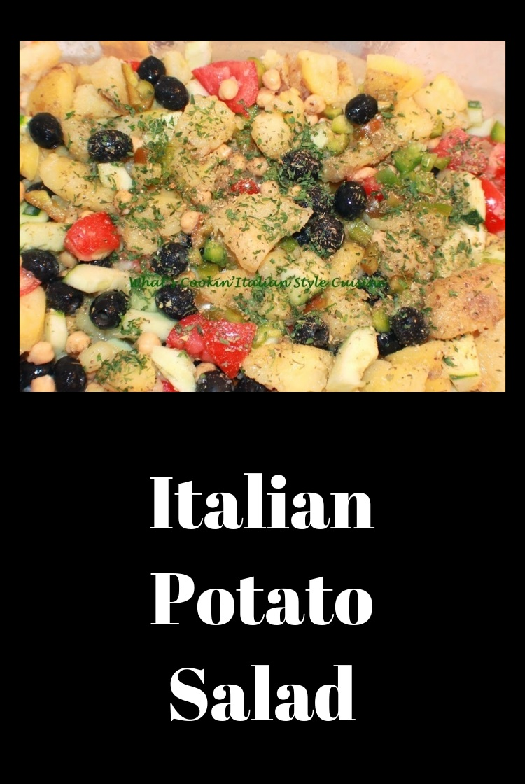 this is a potato salad italian style with herb, spices, seasonings lots of vegetables along with olives and tomatoes, cubes mozzarella, meats