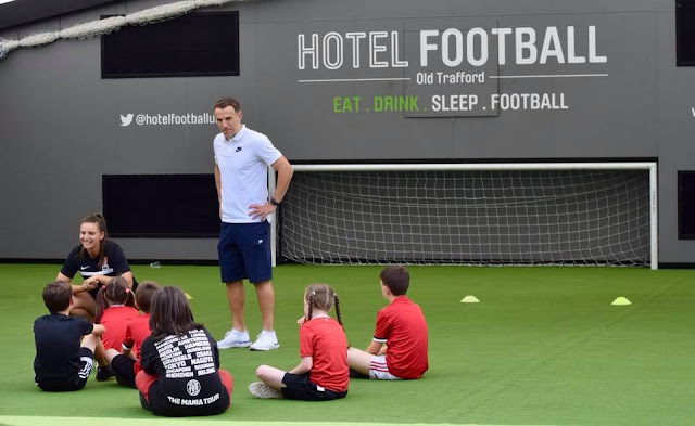 Phil Neville teaching kids football