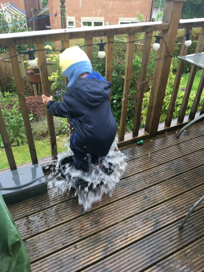 2017-year-review-May-bear-in-hat-and-coat-jumping-in-puddle