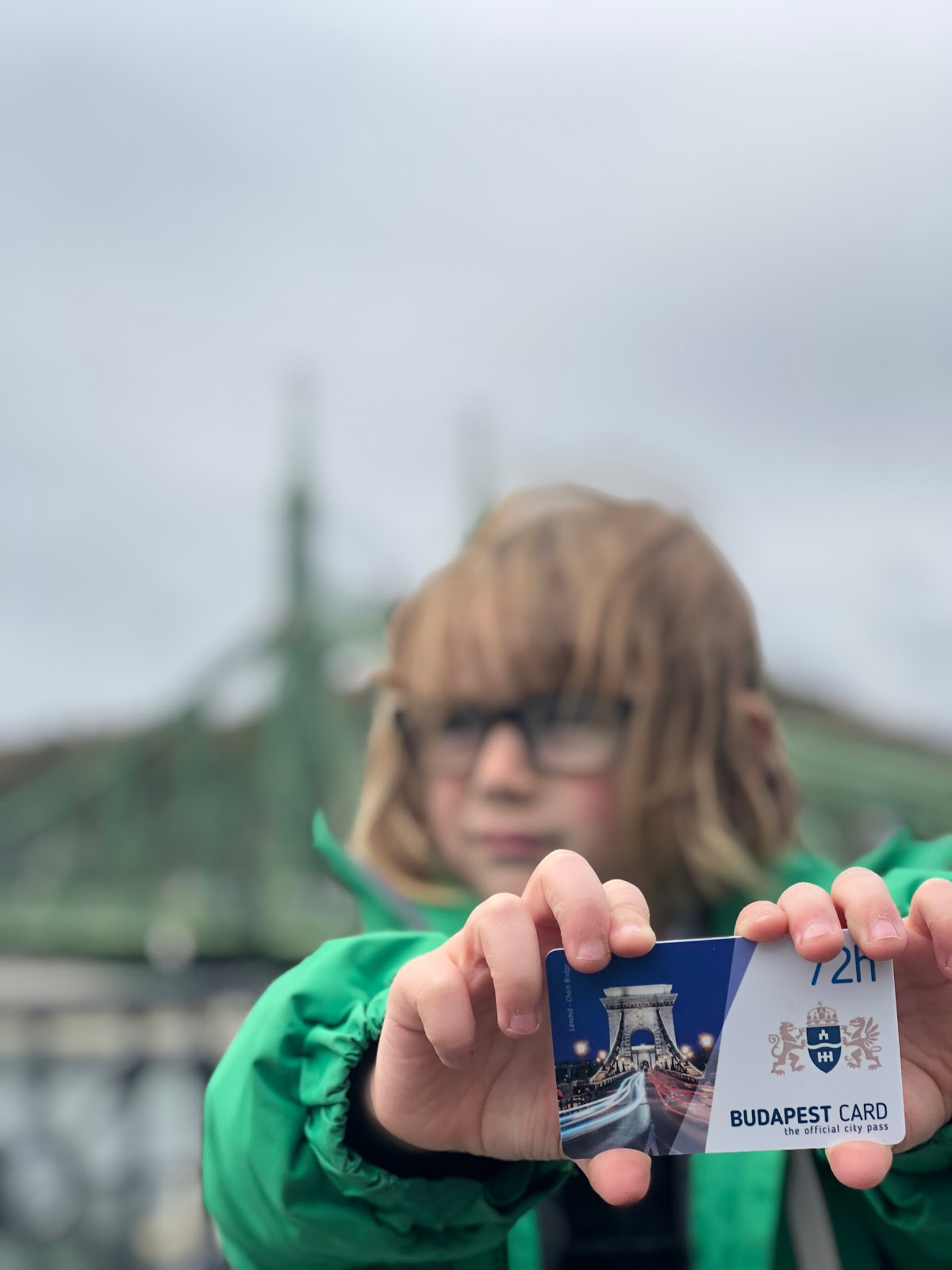 Young boy holding the Budapest travel card