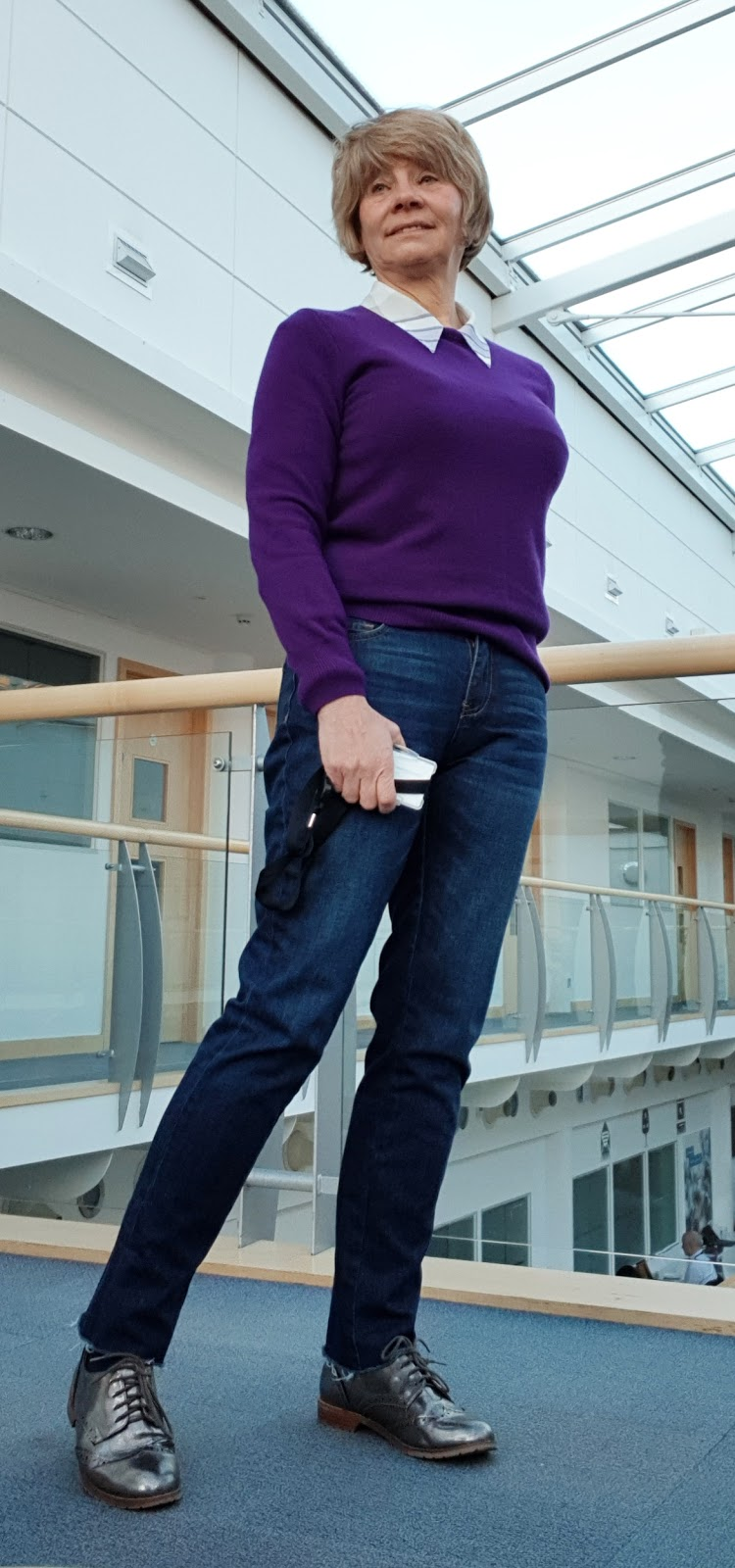 Image showing Is This Mutton? blogger Gail Hanlon in a casual outfit for dress down Friday: jeans, metallic brogues, purple cashmere jumper.