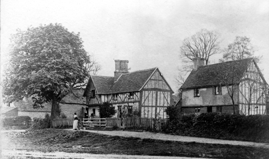 Photograph of Mother Chuck's Cottages on Water End green. Photograph by Geo. Knott, 1900.