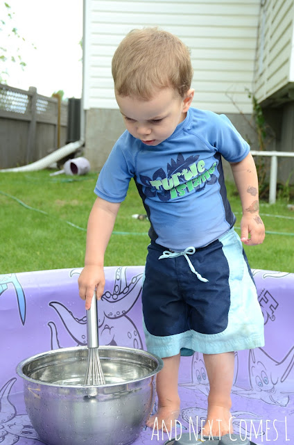 Child banging metal bowls as part of a musical science pool activity for kids