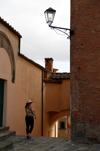 Katy Standing in Piazza in San Miniato Tuscany Italy