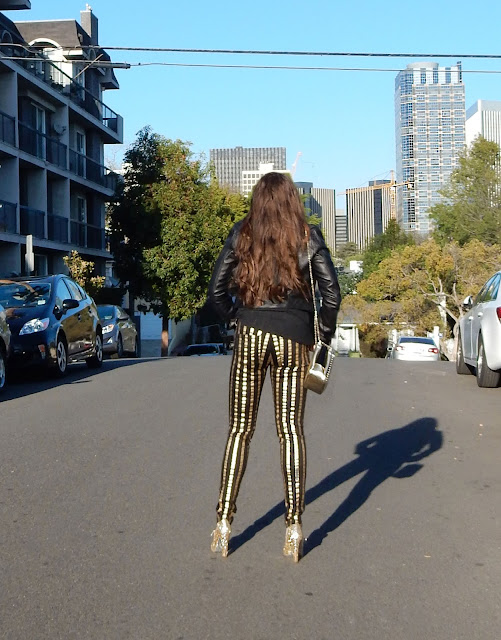Marisa Stewart The High Heeled Brunette loves her Frankie B funky Striped jeans, Louboutin bag, Cusp by Neiman Marcus leather Moto Jacket, and Miu Miu Shoes