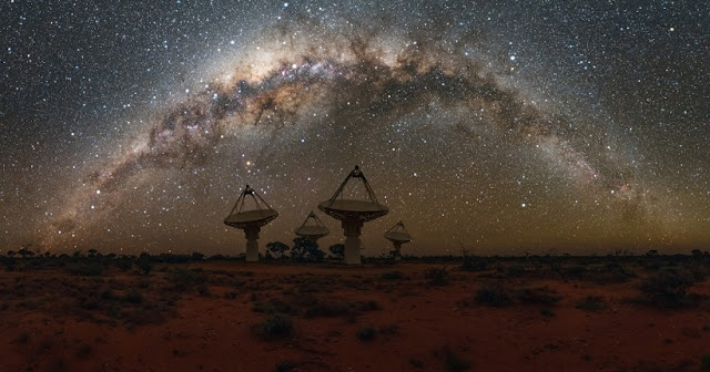 Antennas of CSIRO's Australian SKA Pathfinder with the Milky Way overhead. Credit: Alex Cherney/CSIRO