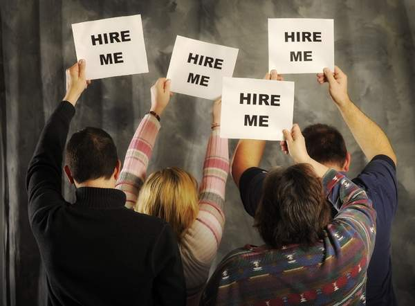 job hunters holding up 'help me' signs