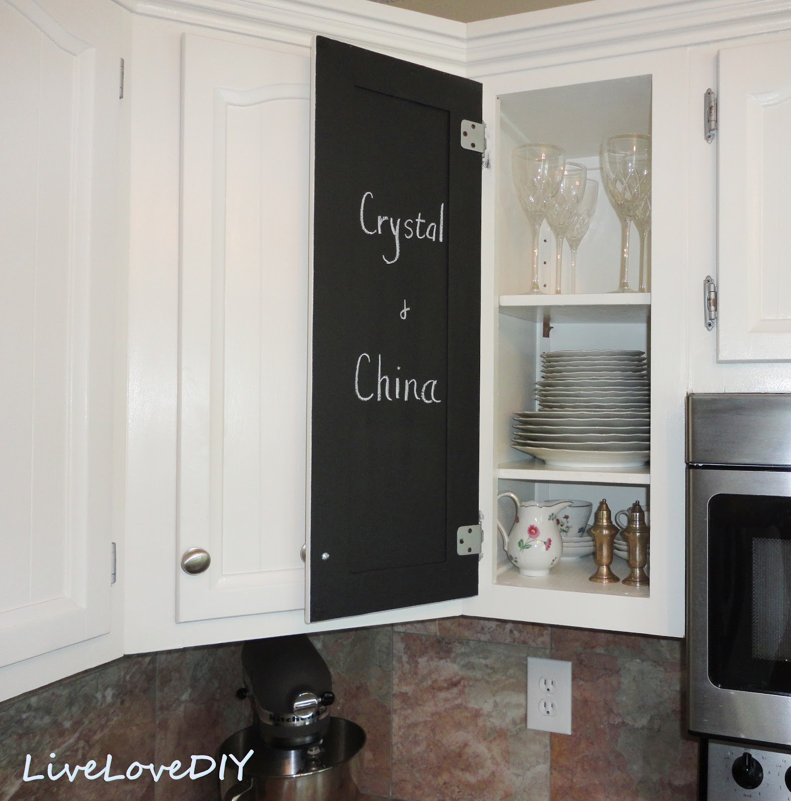 LiveDIY: The Chalkboard Paint Kitchen Cabinet Makeover on painting cabinets white, painting wooden cabinets, painting kitchen cabinet doors only, painting kitchen cabinet doors colors, painting cabinets without sanding, painting kitchen drawers, painting inside bookshelves, painting an old kitchen, painting inside walls, painting cabinets two different colors, color inside cabinets, painting inside painting, painting inside glass, painting inside fireplaces, painting inside drawers, painting pressboard cabinets, painting inside doors, painting inside of bookcases, painting stained cabinets, painting trailer house cabinets,