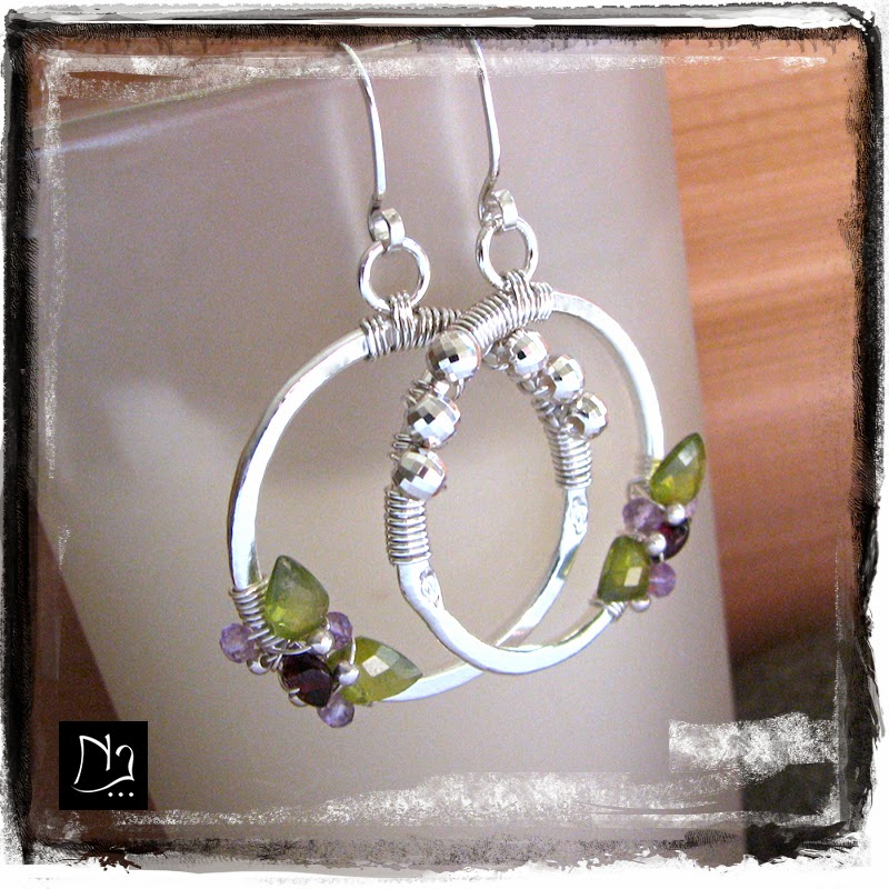 http://www.nathalielesagejewelry.com/collections/sterling-silver-designer-earrings/products/flower-earrings-august