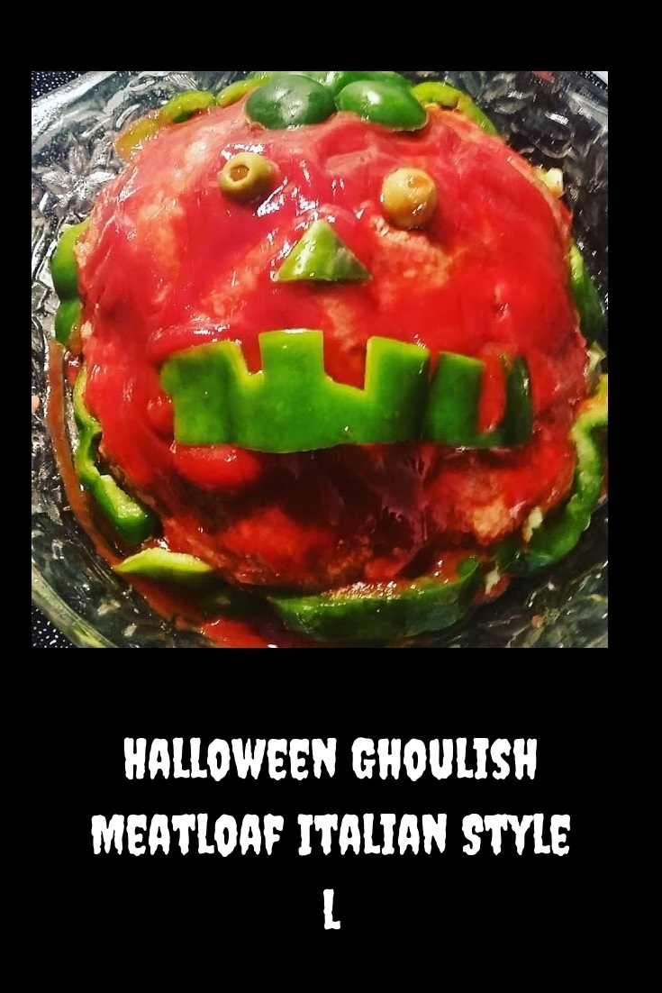 This is a meatloaf decorated for Halloween to look like a scary pumpkin wiht olives and peppers for teeth for Halloween.