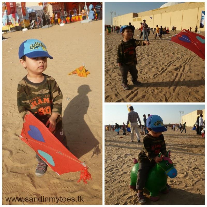 my toddler at the kite festival dubai
