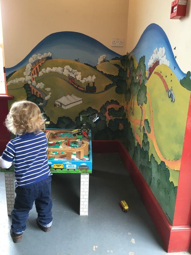 toddler-playing-with-table-at-perrygrove-railway