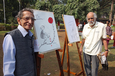 S. D. (Shi Da) Phadnis and Mangesh Tendulkar with their cartoons