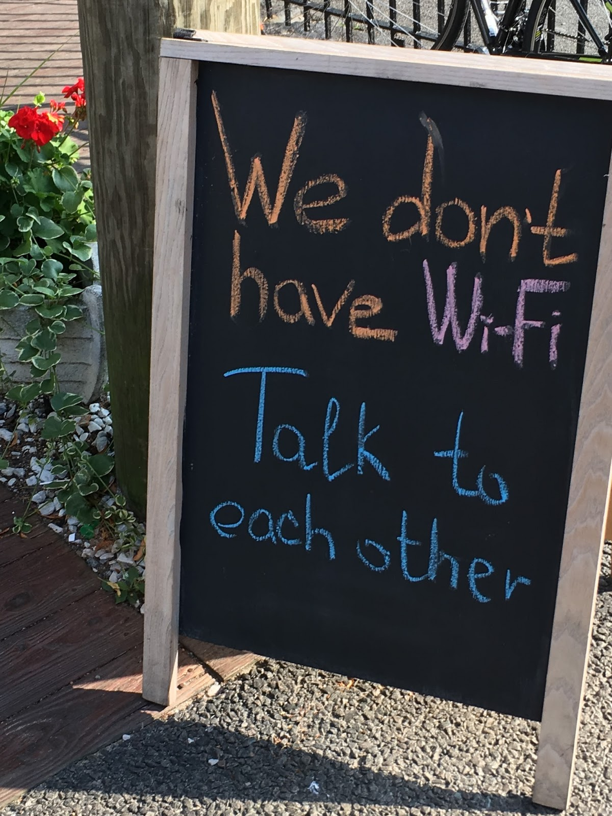 Sign saying: We don't have wi-fi, talk to each other