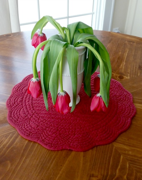 Wilted Red Tulips On Table