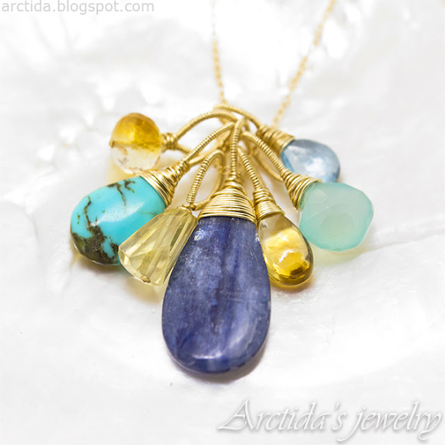 https://www.arctida.com/en/home/125-blue-topaz-kyanite-mint-chalcedony-turquoise-citrines-gold-filled-olga.html