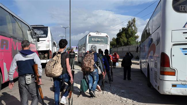 Militants begin evacuating town in Syria's Homs province