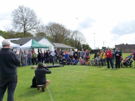 The crowd looks on as I throw a currant bun at the first-ever Abingdon World Bun Throwing Championship back in 2012