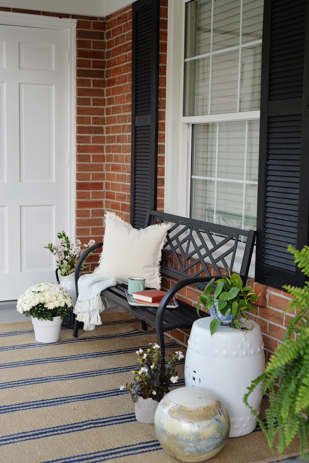front porch decorating ideas for summer, fresh traditional front porch decor with sitting bench and striped Annie Selke rug