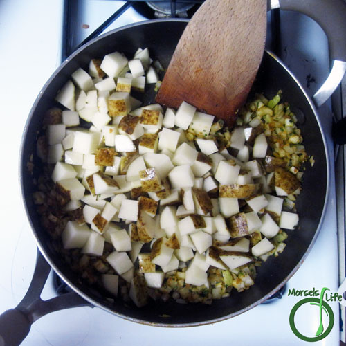 Morsels of Life - Rosemary Skillet Potatoes Step 3 - Add in potatoes and cook to desired crispness.