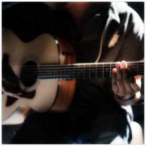 Man with guitar buy Gabriel Gurrola on Unsplash