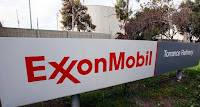 This Jan. 30, 2012, file photo shows the sign for the Exxon Mobil Torrance Refinery in Torrance, Calif. Exxon Mobil held its annual shareholder meeting Wednesday, May 25, 2016, as it faces volatile crude prices and investigations into what it knew and allegedly didn't disclose about oil's role in climate change. (Credit: Associated Press) Click to Enlarge.