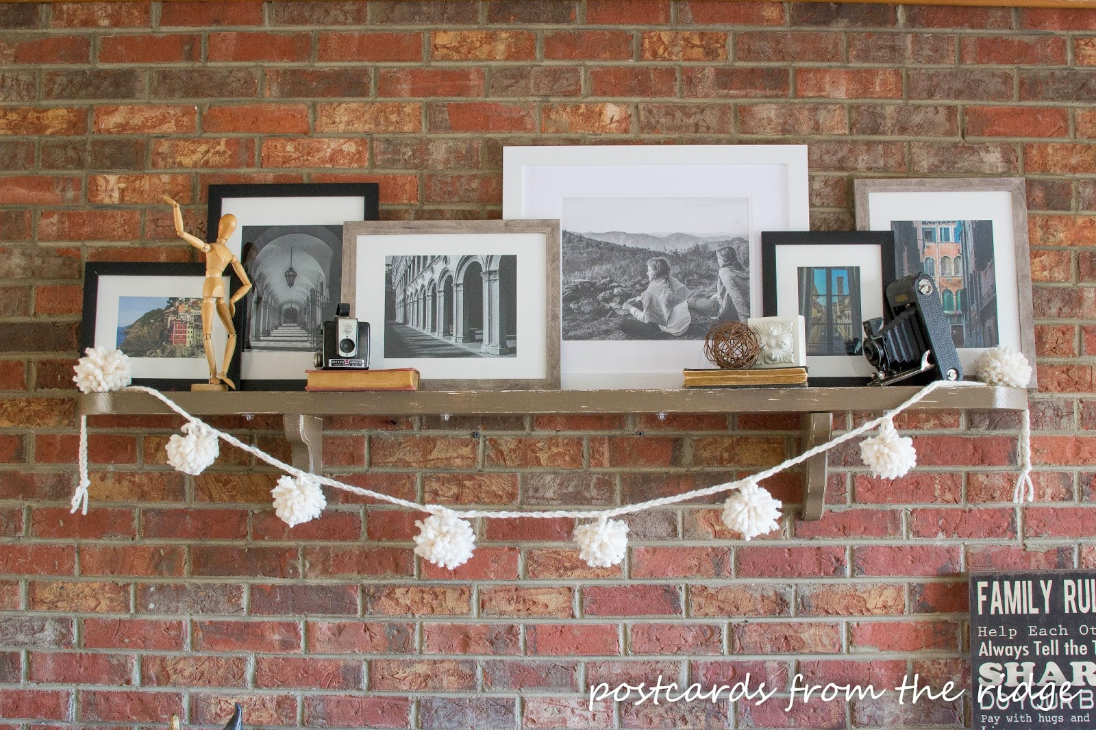 yarn pom pom on fireplace mantel