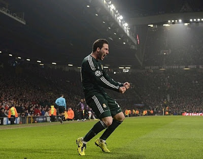 Higuain at Old Trafford playing with Real Madrid green jersey