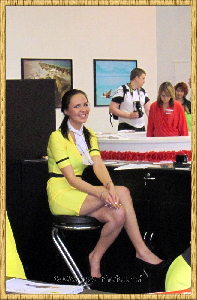 Smiling Promotional Model Yellow Dress