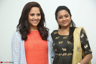 Actress Suma in Black Salwar Suit and Anusuya in orange Dress at winner movie press meet part 1 February 2017 (10).JPG