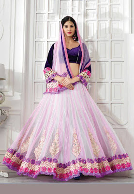 Beautiful Indian Model Girl In Off Off White And Light Pink Net Lehenga Choli.