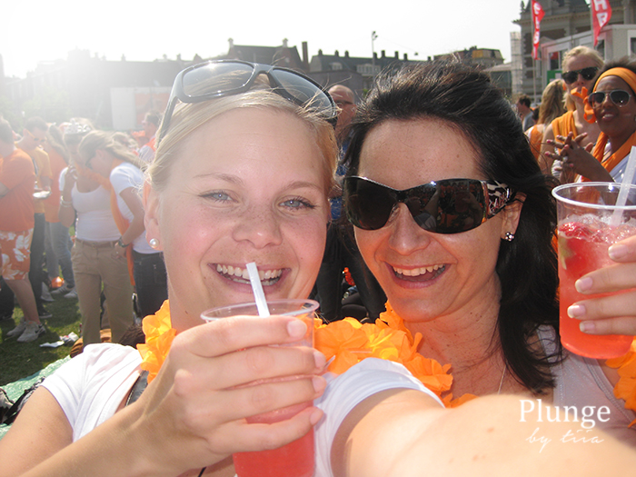 Finnish girls celebrating Queens Day in Amsterdam